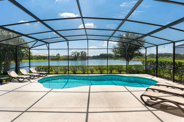 Large pool deck with loungers and amazing lake view