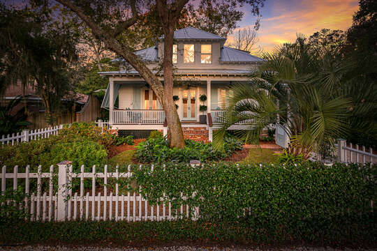 The fencing, with vines crawling it, of this place to stay in St. Simons Island GA.