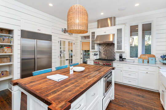 Kitchen of this place to stay in St. Simons Island GA, with modern appliances and a center island with seating.