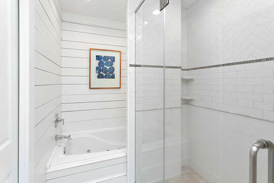 The walk in shower and large tub of the master bathroom.
