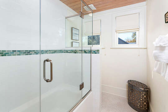 Massive walk in shower in this home, with glass doors.