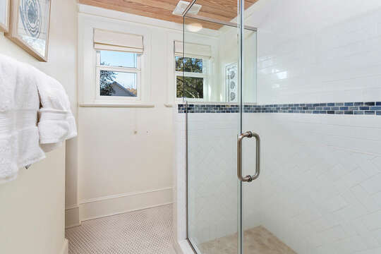 Large walk in shower with glass doors in the upstairs bathroom.