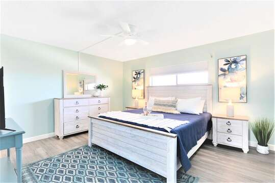 Spacious Master Bedroom with king bed, huge TV and ensuite