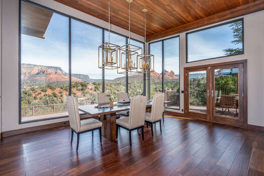 To Round Out the Great Room is the Dining Area with More of the Exquisite Views and Access to the Private Deck with More Dining Space and a BBQ Grill