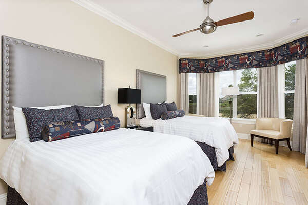 Two full beds are located in this upstairs bedroom