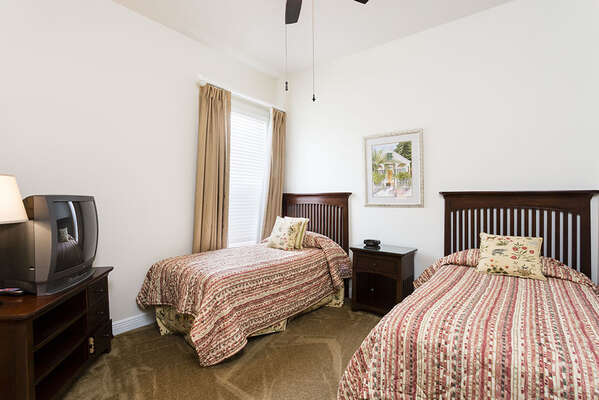 The third bedroom features two twin beds
