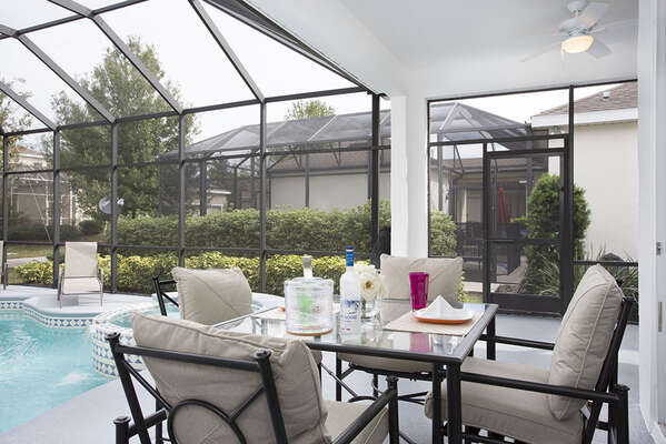 Relax underneath the covered lanai on comfortable patio furniture