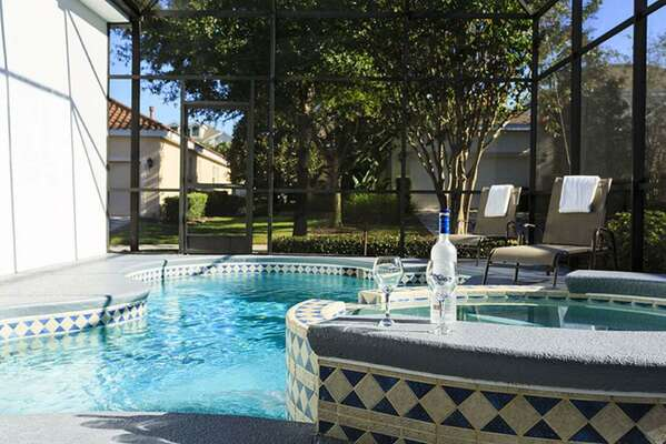 Enjoy your screened in pool and spillover spa