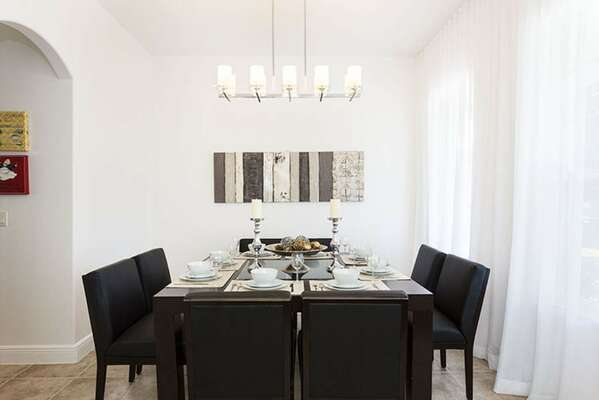 Dine at the formal dining table with seating for 8