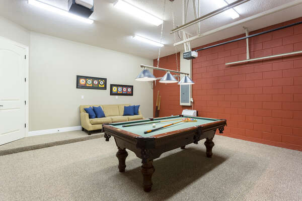 Garage game room with pool table