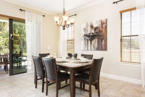 The whole family can dine together at the formal dining table with seating for 6