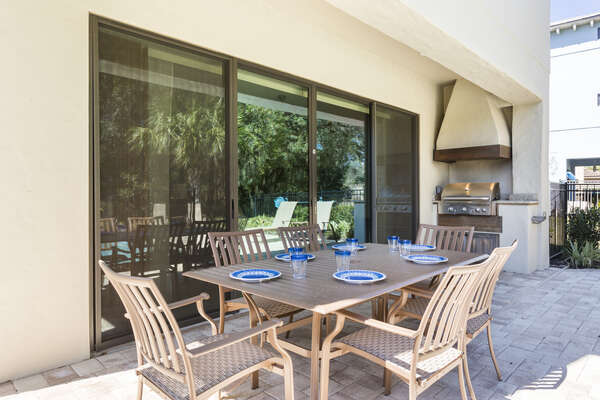 Dine al fresco at the outdoor dining table for 6
