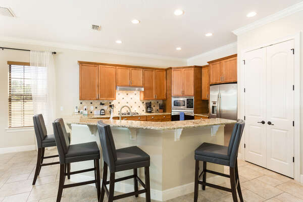 Eat a snack or quick meal at the breakfast bar with seating for 4