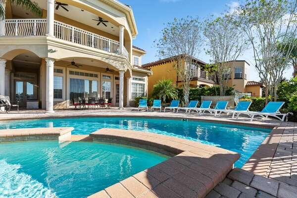 Lounge poolside at your own private pool and spillover spa
