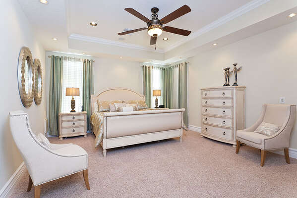 Third bedroom features a plush king bed