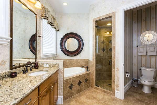 Ensuite bathroom featuring garden tub and walk in shower