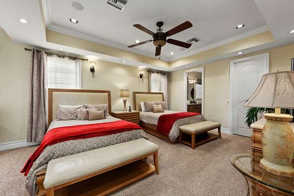 Spacious master suite with two Queen beds and ensuite bathroom