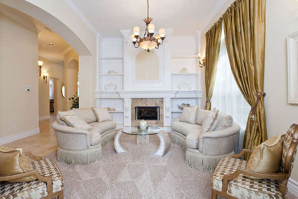 A studding formal living room welcomes you into the home