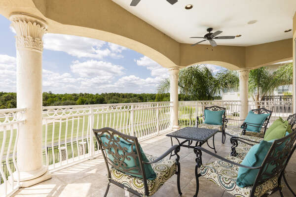 The oversized balcony features comfortable patio furniture and unbeatable views
