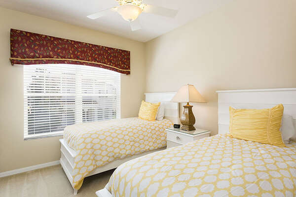 This bright twin/twin bedroom is fun for kids and teens