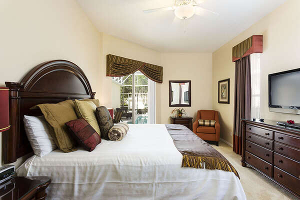 First floor king master suite with pool deck access