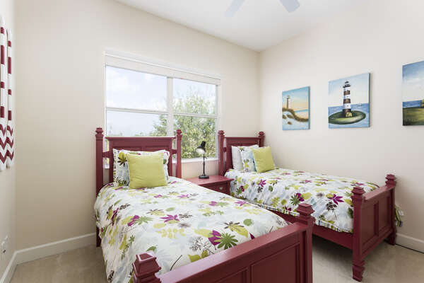Comfortable bedroom with two twin beds