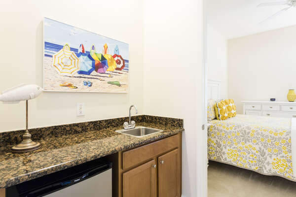 A wet bar is located in the home for beverages or snacks