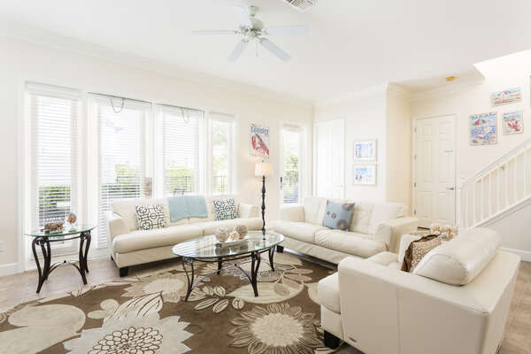 Relax in this sunny living space on comfortable couches