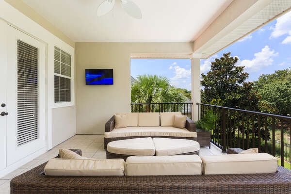 Relax on the gorgeous balcony with plush patio furniture and even an outdoor TV