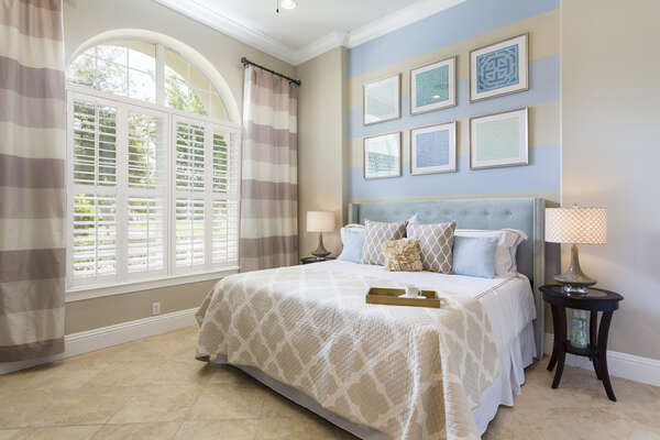 Beautiful first floor master bedroom with plenty of natural light