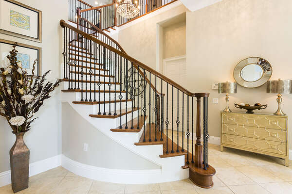 Beautiful sweeping staircase and tasteful decor greet you as you enter your villa