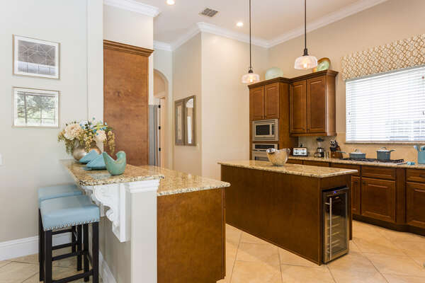 Fully-equipped kitchen with upgraded granite countertops