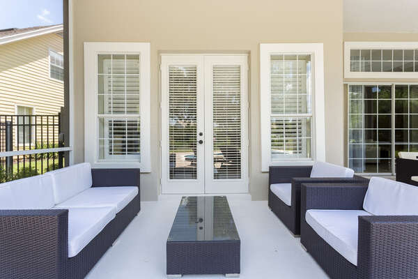 Plush patio furniture located outside of the master bedroom doors