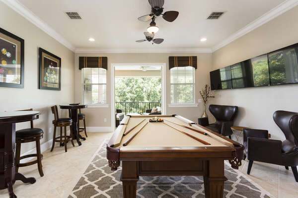Head upstairs to the loft game area with a pool table