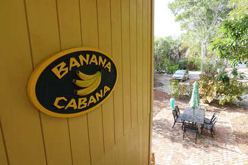 Banana cabana sign, house stairwell looking out to the front yard and parking