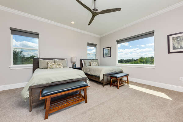 Spacious bedroom with plenty of natural light and two full beds