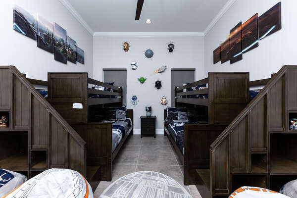 This fun galactic kids bedroom is located on the first floor, with two twin over full bunks