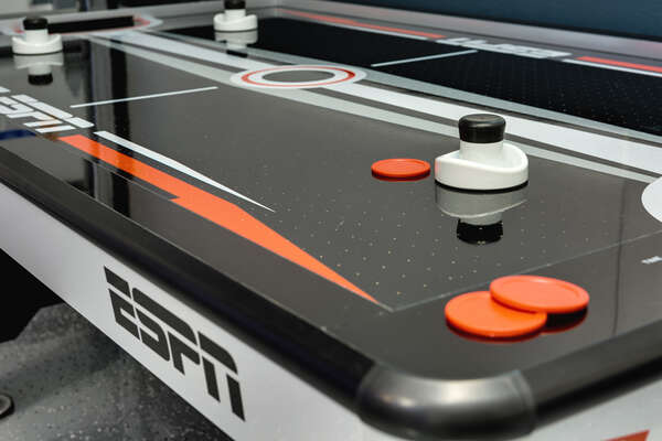 Challenge your family members to Air Hockey