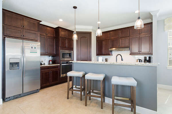 Enjoy a snack or quick meal at the breakfast bar with seating for 3