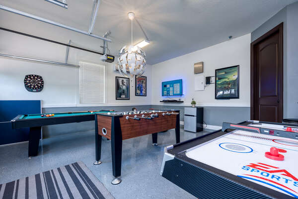Complete with foosball, pool and an air hockey table