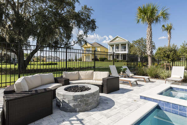 Relax on comfortable outdoor patio furniture and gather around the fire