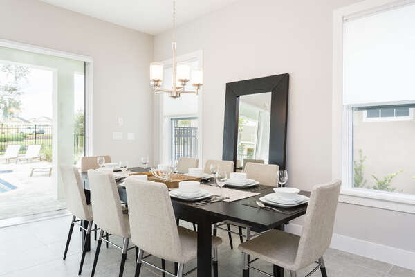 Sit down and dine together at the formal dining table with seating for 8