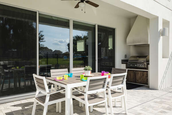 Enjoy meals al fresco underneath the covered lanai with a table for 6