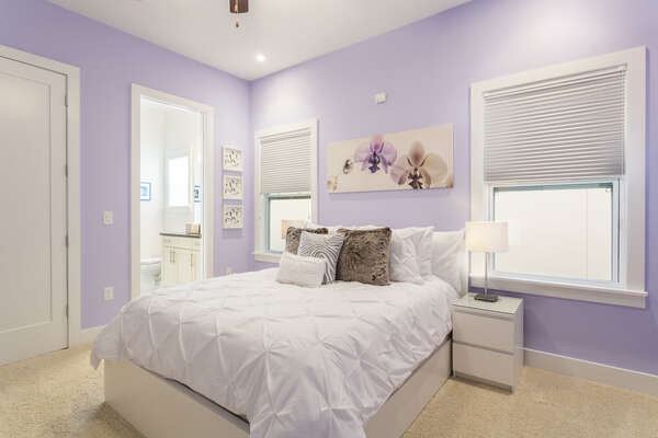 Sleep well in this gorgeous pastel bedroom with a Queen bed