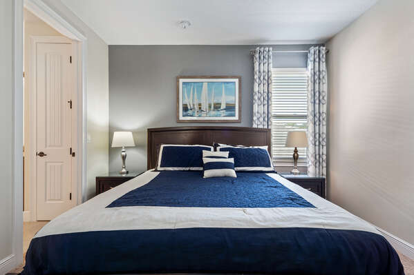 Upstairs king-size bedroom with a nautical theme