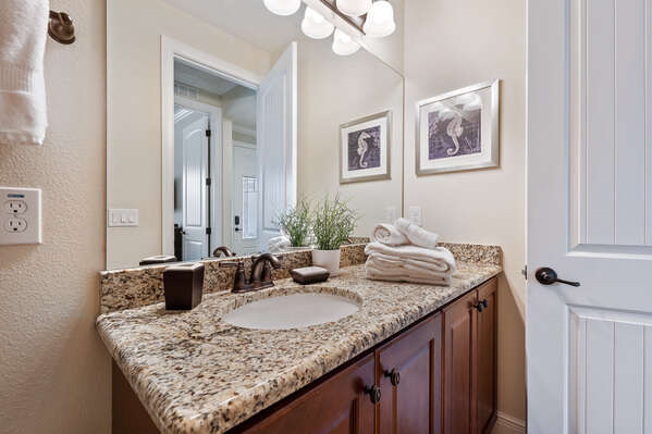 Get ready at this vanity with granite countertop