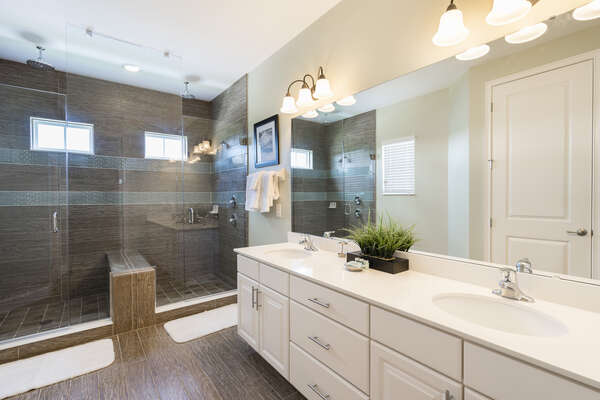 The master bathroom has dual vanities and dual showers and rain shower heads
