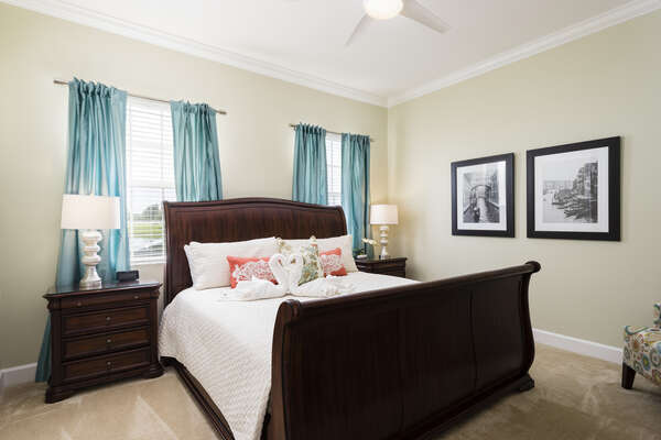 The second master bedroom boasts a beautiful king sized bed