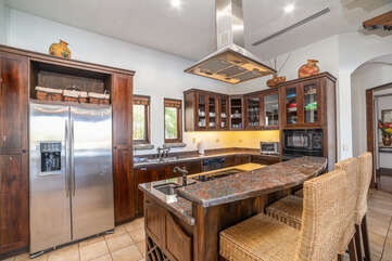 Downstairs Fully equipped kitchen with breakfast bar