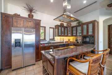 Upstairs kitchen with modern appliances and granite countertops